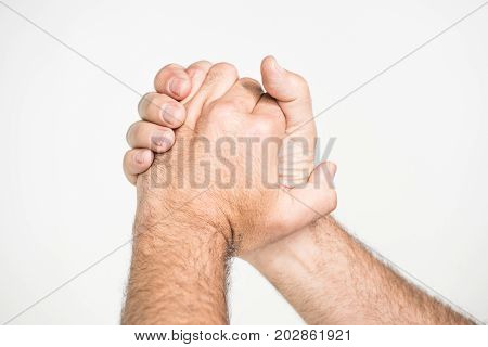 Man Holding Hands In Triumph