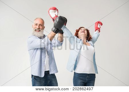 Couple Triumphing In Boxing Gloves