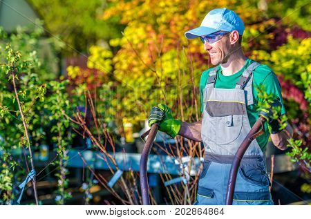 Happy Landscaping Worker. Caucasian Gardener in a Good Mood.