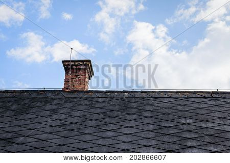 An old chimney on top of an old house