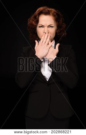 Businesswoman Covering Mouth