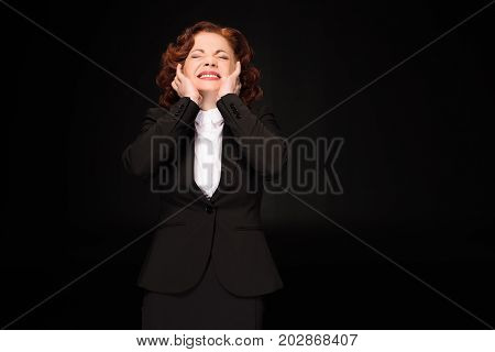 Businesswoman Covering Ears