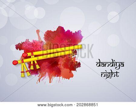 illustration of Dandiya sticks with dandiya night text on the occasion of hindu festival Navratri