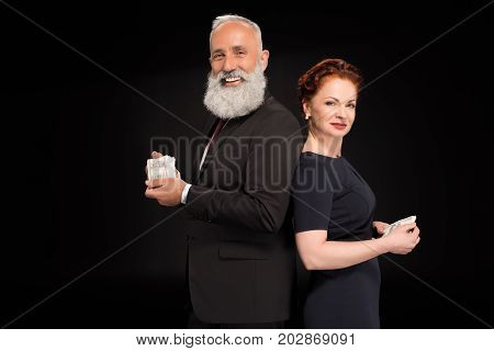 Man And Woman Holding Bundles Of Money