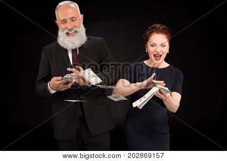 Man And Woman Throwing Money