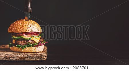 Mouth-watering, Delicious Homemade Burger Used To Chop Beef. On The Wooden Table. The Burgers Are In