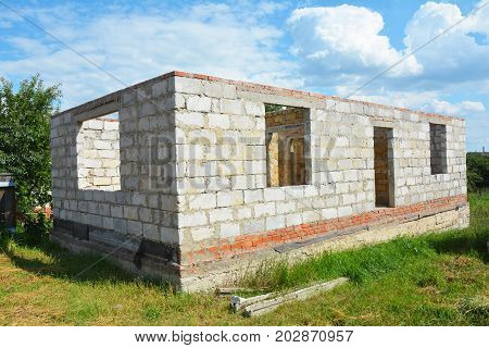 Building House from Autoclaved Aerated Concrete Blocks with concrete lintel and Unfinished Roof. poster