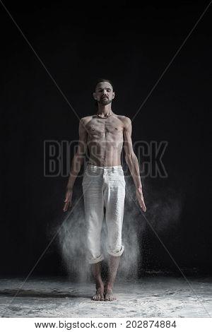 Sporty caucasian young man working out, yoga, pilates, fitness training, basic standing asana tadasana, mountain yoga posture