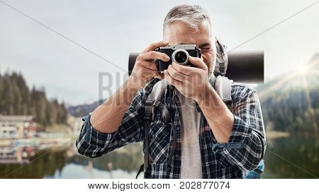 Explorer Shooting Pictures In Nature