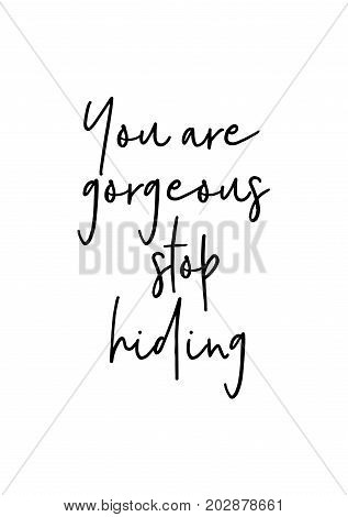 Hand drawn lettering. Ink illustration. Modern brush calligraphy. Isolated on white background. You are gorgeous stop hiding.