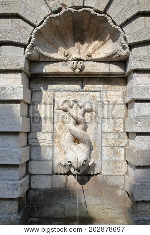 An old fountain with two fishes in Boulogne sur Mer, Cote d'Opale, Pas de Calais, Hauts de France