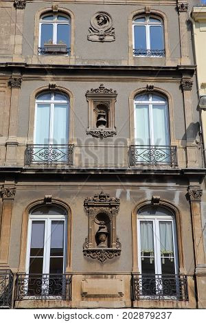 BOULOGNE SUR MER, FRANCE - AUGUST 28, 2017: Restored facades with carvings, Cote d'Opale, Pas de Calais, Hauts de France