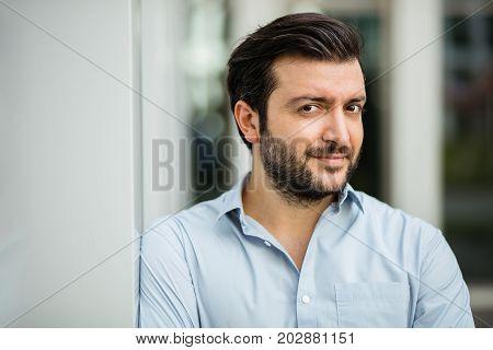Elegant Man In Blue Shirt Outside
