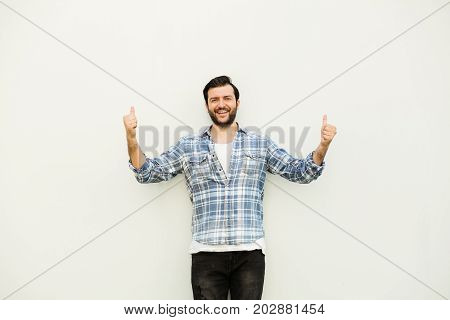 Man With Squared Shirt On Gray