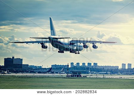 Landing of the big cargo airliner at sunny evening time.