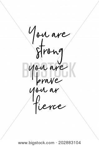 Hand drawn lettering. Ink illustration. Modern brush calligraphy. Isolated on white background. You are strong you are brave you are fierce.