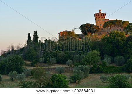 Summer Tuscany, sunrise. Typical Tuscan landscape. Val d'Orcia, Tuscany, Italy, Europe, image toned. 16 of July 2017.