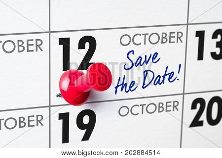 Wall Calendar With A Red Pin - October 12