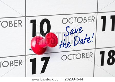 Wall Calendar With A Red Pin - October 10