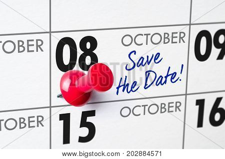 Wall Calendar With A Red Pin - October 08