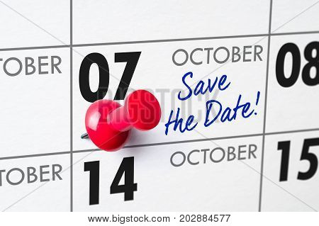 Wall Calendar With A Red Pin - October 07