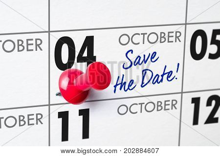 Wall Calendar With A Red Pin - October 04