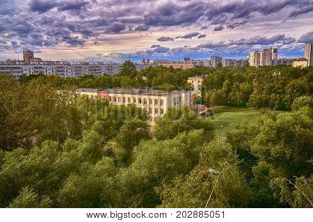 View of the usual moscow school building with football field