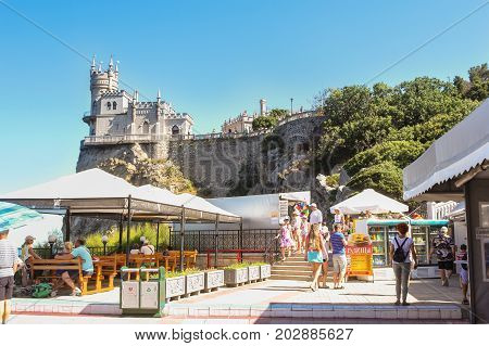 Yalta, Crimea - 11 July, Visitors on the bottom platform, 11 July, 2017. Small Castle Lastochkino Nest and its surroundings.