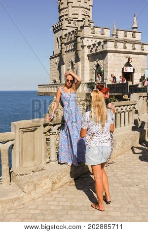 Yalta, Crimea - 11 July, People in the background of the castle, 11 July, 2017. Small Castle Lastochkino Nest and its surroundings.