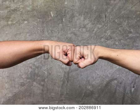 A fist bump or power five is a gesture of giving respect or approval