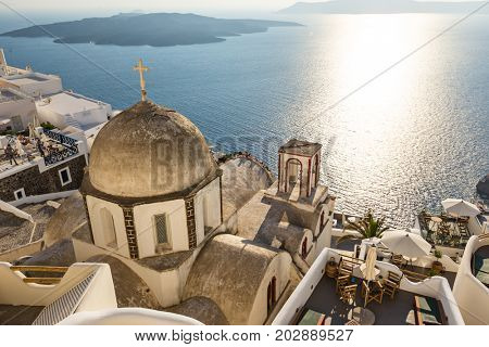 Old church dome on the edge of the town of Fira on Santorini island, Greece.