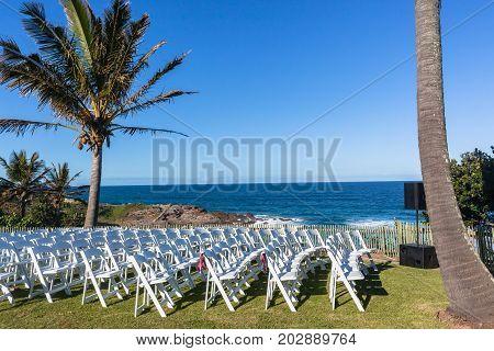 White Chairs Wedding Venue Beach Ocean Horizon Landscape.