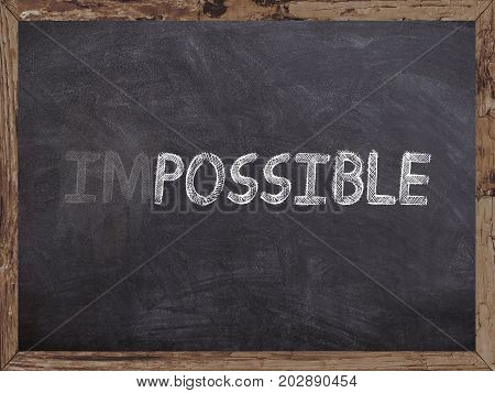 Impossible erase in possible writed on a blackboard with wooden frame