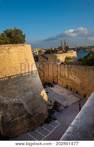 Ancient Walls And Bastions Of Valetta Fortress In Late Afternoon Lights