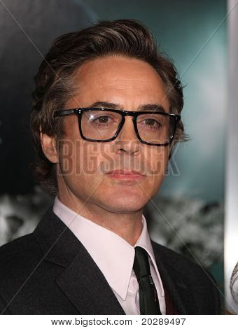 """LOS ANGELES - FEB 16:  Robert Downey Jr. arrives at the """"Unknown"""" Los Angeles Premiere on February 16, 2011 in Westwood, CA"""