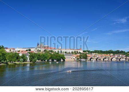 Prague castle and Charles bridge over Vltava river landmark