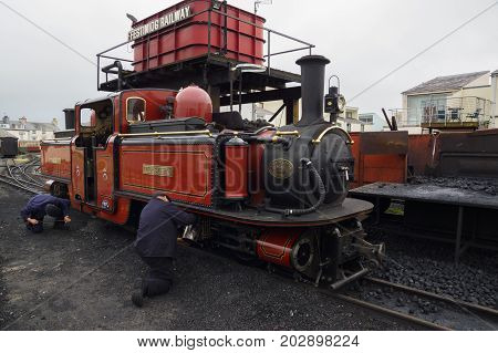 Porthmadog Wales UK - September 4 2017: Narrow gauge steam locomotive David Lloyd George of the Ffestiniog Railway Company having maintenance performed at a coaling station