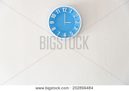 Good afternoon or after midnight with 03:00 clock on white concrete wall interior background with copy space message board concept. 3 pm is a coffee break time in the afternoon. 3 am is the late night