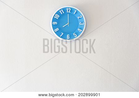 Good morning or night time with 8:00 clock on white concrete wall interior background with copy space message board concept. Good morning is the greeting in the morning 8am is the working time
