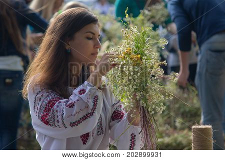 Kiev Ukraine - July 06 2017: Girl wreathes a wreath of herbs and flowers at the festival in honor of the national holiday of Ivan Kupala