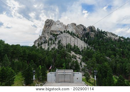A developing thunderstorm backdrops Mount Rushmore National Monument