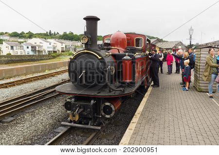 Porthmadog Wales UK - September 4 2017: Narrow gauge steam locomotive David Lloyd George of the Ffestiniog Railway Company being admired by tourists and passengers