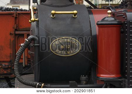 Porthmadog Wales UK - September 4 2017: Brass name plate and details on the smoke box of the narrow gauge steam locomotive David Lloyd George of the Ffestiniog Railway Company