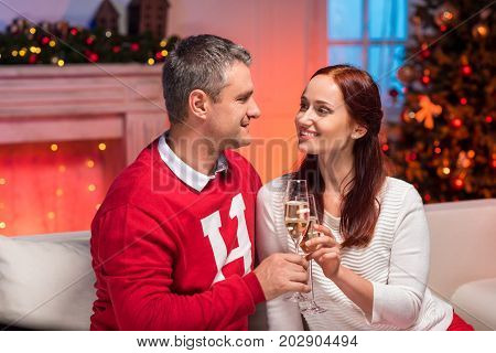 Couple Clinking Glasses Of Champagne