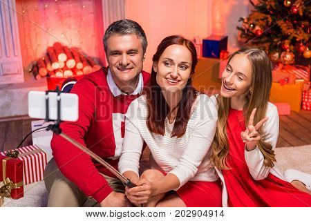 Family Taking Selfie On Christmas