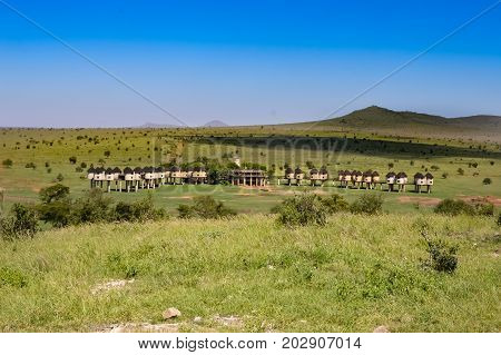 Hotel with huts on stilts in the savannah of Tsavo West park in Kenya