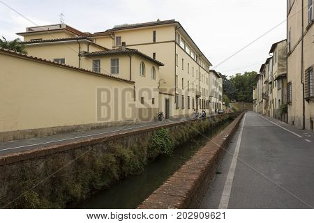 LUCCA, ITALY - AUGUST 15 2015: Ditch road in Lucca City in Tuscany Italy