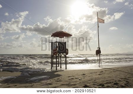 MARINA DI MASSA, ITALY - AUGUST 17 2015: Sunset view of a lifeguard tower at sunset time in Versilia Italy