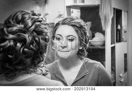 Morning Of The Bride. The Bride Is Having A Look At The Mirror. Portrait Of A Beautiful And Young Br