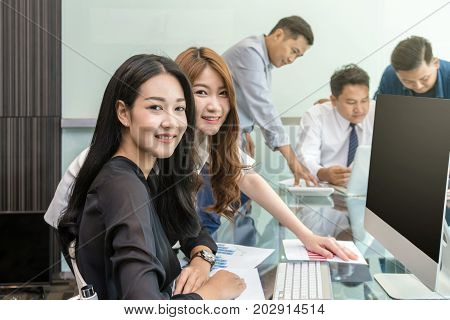 Group Of Asian Business people with casual suit working and talking together in the modern Office people business group concept
